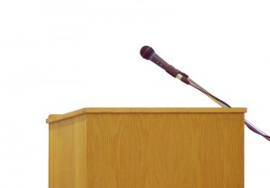 Lectern with a microphone1 300x209 3 more tips to improve your oral presentation skills
